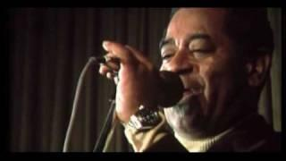 "Dizzy Gillespie bopping and somekind of expression (""All You Need Is Love"")"